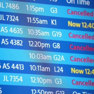 CHICAGO, IL - NOVEMBER 26: An electronic board shows flight delays and cancellations at O'Hare International Airport after an early winter snowstorm left more than 7 inches of snow at the airport on November 26, 2018 in Chicago, Illinois. The storm also caused scores of traffic accidents and left thousands without power. (Photo by Scott Olson/Getty Images)